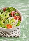 Fresh salad with avocado, tomato and mozzarella Royalty Free Stock Image
