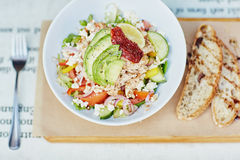 Fresh salad with avocado and tomato presented rustical Royalty Free Stock Images