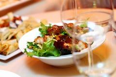 Fresh salad on banquet table Stock Photos