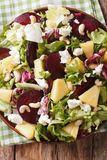 Fresh salad of beets, pineapple, goat cheese, cashews and greens Stock Photos
