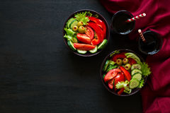 Fresh salad with beverages. On black background. Top view Royalty Free Stock Photo
