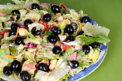 Fresh salad with black olives and avocado Stock Images