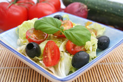Fresh salad with black olives Royalty Free Stock Photos