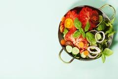 Fresh salad on blue background Stock Photo