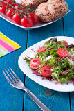 Fresh salad on blue wooden table Royalty Free Stock Photos