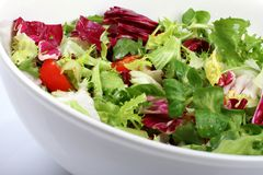 Fresh salad in a bowl. Fresh salad in a white bowl Royalty Free Stock Image