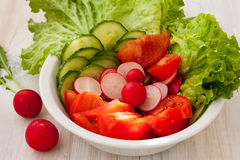 Fresh salad in the bowl Stock Photos