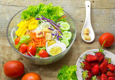 Fresh salad bowl and strawberry Royalty Free Stock Image
