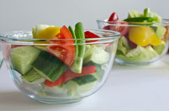 Fresh salad bowls Stock Photos