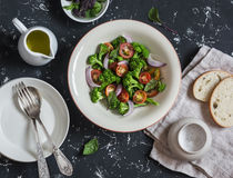 Fresh salad with broccoli and tomatoes on a dark background. Royalty Free Stock Photo
