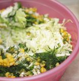 Fresh salad with canned corn, cabbage and parsley stock images