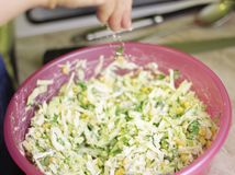 Fresh salad with canned corn, cabbage and parsley royalty free stock photography