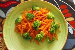Fresh salad. Fresh carrot salad with broccoli Royalty Free Stock Photos