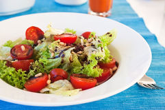 Fresh salad with cherry and lettuce Royalty Free Stock Images