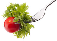 Fresh salad and cherry tomato on fork isolated on white backgrou Royalty Free Stock Image