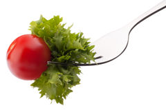 Fresh salad and cherry tomato on fork isolated on white backgrou Royalty Free Stock Photography