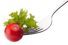 Fresh salad and cherry tomato on fork isolated on white backgrou Stock Photography