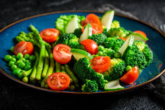 Fresh salad with cherry tomatoes, asparagus and broccoli Royalty Free Stock Photo