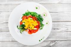 Fresh salad with cherry tomatoes, cucumber, radish, sweet pepper Stock Photo