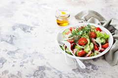 Fresh salad with cherry tomatoes, cucumbers, radishes, dill and olive oil. Selective focus Stock Photography