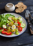 Fresh salad with cherry tomatoes, cucumbers, sweet peppers, celery and quail eggs. Royalty Free Stock Photo
