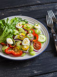 Fresh salad with cherry tomatoes, cucumbers, sweet peppers, celery and quail eggs. Stock Photo