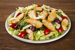 Fresh salad with chicken breast, arugula, olive and tomato. Heal Royalty Free Stock Photography