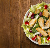 Fresh salad with chicken breast, arugula, olive and tomato. Heal Stock Photos