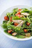 Fresh salad with chicken, tomato and greens (spinach, arugula) on blue wooden background close up Stock Photos