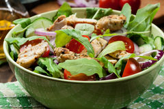 Fresh salad with chicken, tomatoes and arugula on plate Stock Images