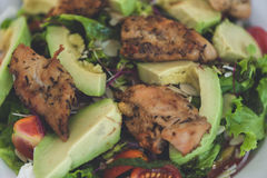 Fresh salad with chicken,tomatoes and avocado Stock Photo