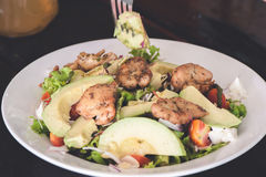 Fresh salad with chicken, tomatoes and avocado close up Stock Image