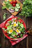 Fresh salad with chicken, tomatoes, eggs and arugula on plate Royalty Free Stock Photo