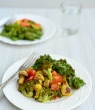 Fresh Salad consisting of Mushrooms, Broccolli, spinach cherry tomatoes Royalty Free Stock Photo