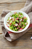 Fresh salad with crispy radishes Stock Photo