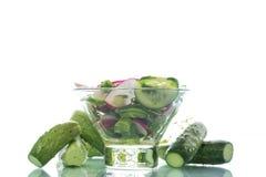 Fresh salad with cucumber and radish. Fresh salad with cucumbers and radishes on a white background Royalty Free Stock Image