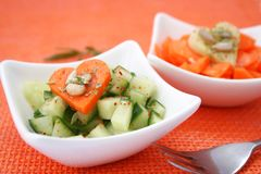 Fresh salad of cucumbers and carrots Stock Images