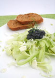 Fresh salad of cucumbers with caviar Stock Images