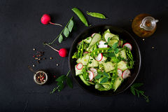Fresh salad of cucumbers, radishes, green peas Royalty Free Stock Photos