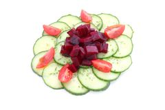 Fresh salad of cucumbers, tomatoes and radish Royalty Free Stock Image