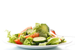 Fresh salad with cucumbers and tomatoes Stock Photo