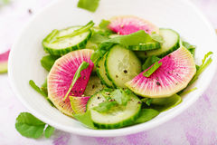 Fresh salad of cucumbers, watermelon radishes Royalty Free Stock Photography