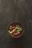 Fresh salad on a dark surface Royalty Free Stock Photography