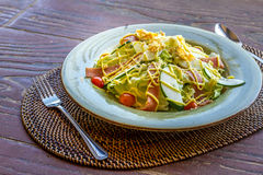 Fresh salad with eggs and vegetables served in a small outdoor r Stock Photography