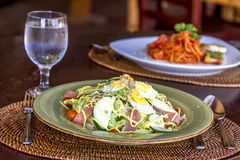 Fresh salad with eggs and vegetables served in a small outdoor r Royalty Free Stock Photo