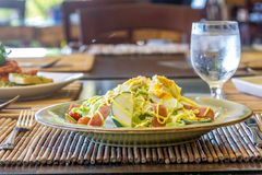 Fresh salad with eggs and vegetables in a small outdoor r Stock Photography