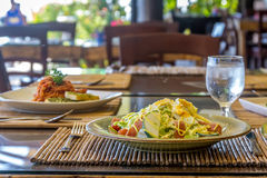 Fresh salad with eggs and vegetables in a small outdoor r Stock Images