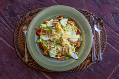 Fresh salad with eggs and vegetables in a small outdoor r Royalty Free Stock Image