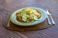 Fresh salad with eggs and vegetables in a small outdoor r Stock Image