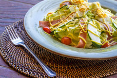 Fresh salad with eggs and vegetables in a small outdoor r Royalty Free Stock Photos